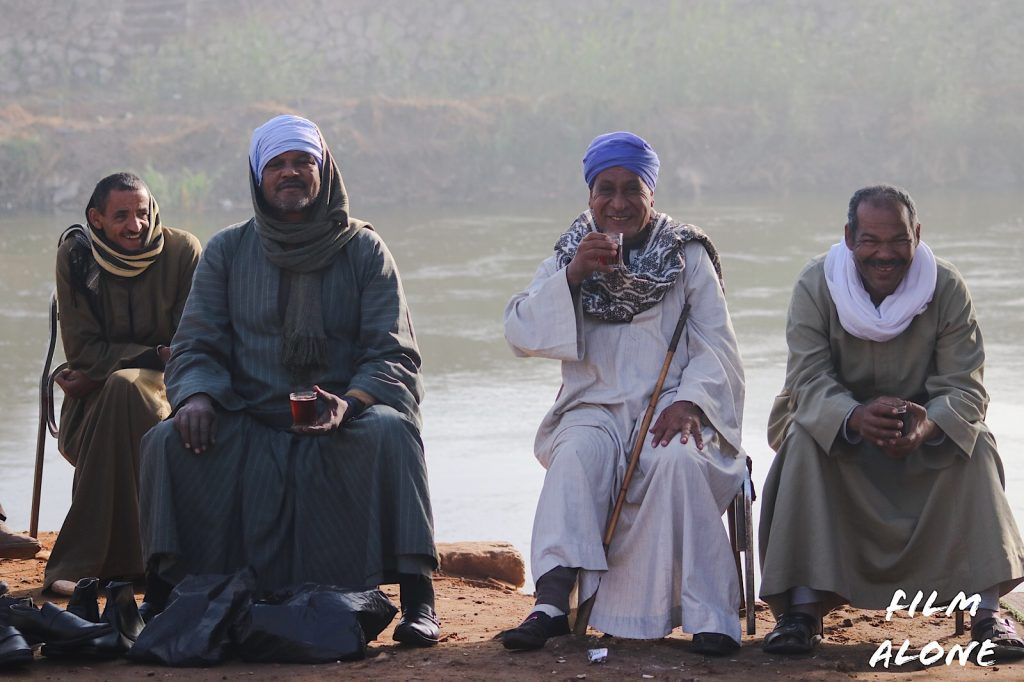 Egyptian men relaxing by the Nile River
