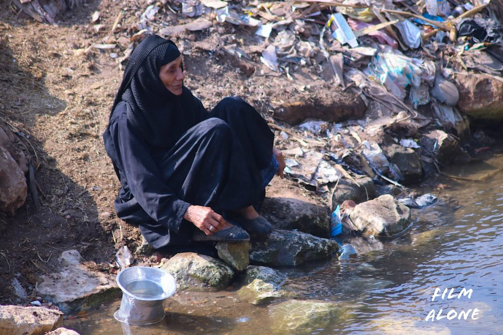 Egyptian woman washing