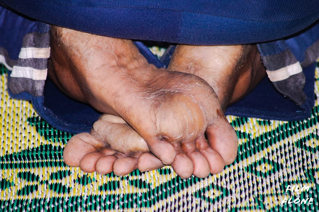 Sudanese feet on the prayer mat