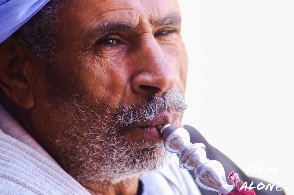Egyptian man smoking the shesha pipe