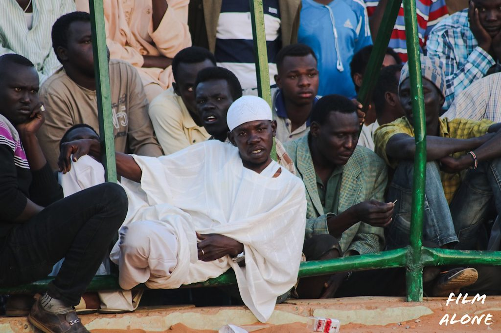 Sudan men watching the wrestling