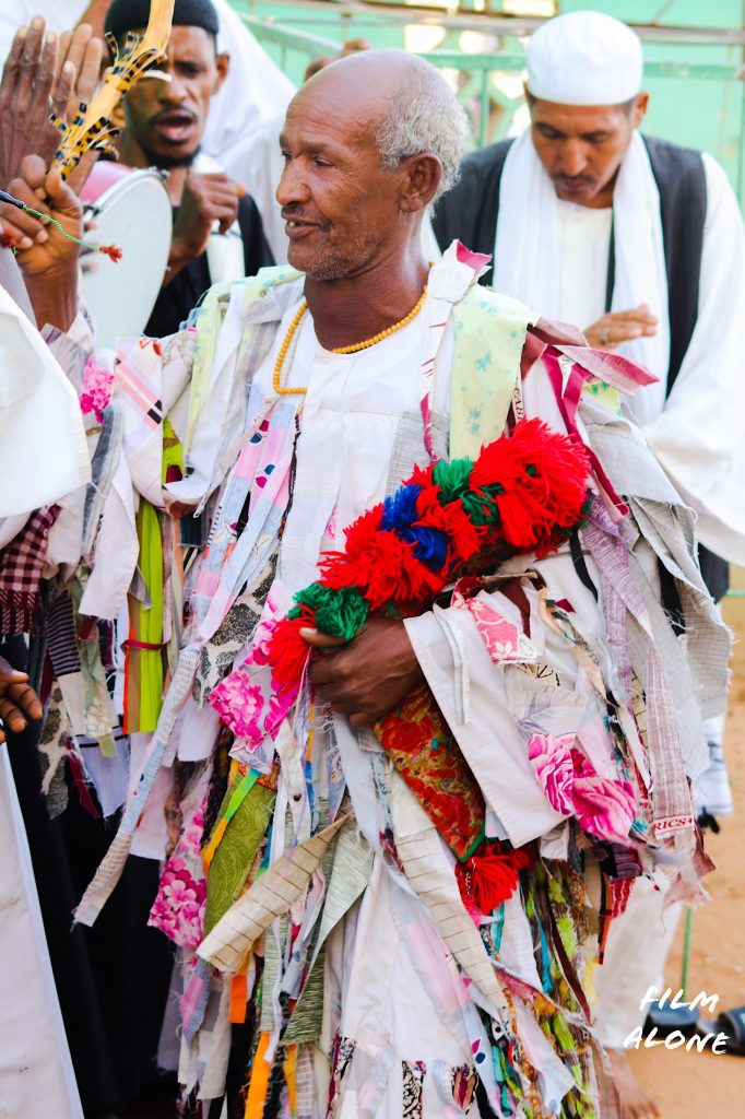 A Sufi man wearing a patchwork robe
